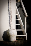 Vessel and chain. A vase, a chain, a staircase in a house by the sea Stock Photo