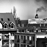 Vessel in the city. Artistic look in black and white. Stock Photo