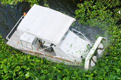 Vessel for clearing waterways. Vessel designed for clearing waterways from plants, mainly water hyacinth, to avoid clogging and closure. Photo taken on a canal Stock Photo