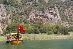 Vessel at Dalyan rock tombs. In Turkey Royalty Free Stock Photo