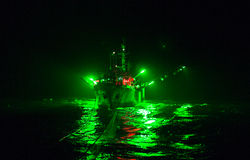 The vessel on a guess-warp. The fishing vessel on a guess-warp, at night, in the light of lamps, fuelled Royalty Free Stock Image