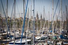 Vessel masts in the harbor of Barcelona, Spain Stock Photo