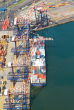 Vessel offloading containers Stock Photos