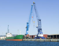 Vessel at port. Cargo operation of a vessel at the port Stock Photos
