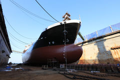 Vessel Tanker on dry dock. Oil tanker vessel black color on top and red color down below on dry dock to do repair royalty free stock image