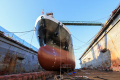 Vessel Tanker on dry dock. Oil tanker vessel black color on top and red color down below on dry dock to do repair stock photos