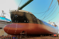 Vessel Tanker on dry dock. Oil tanker vessel black color on top and red color down below on dry dock to do repair royalty free stock photography