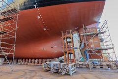 Vessel Tanker on dry dock. Oil tanker vessel black color on top and red color down below on dry dock to do repair propeller stock image