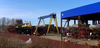 Vessel under construction on the stocks. Vessel under construction is on the stocks under a blue sky on a sunny day Stock Photo