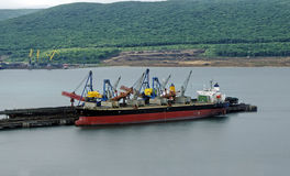 Vessel under loading Stock Photos