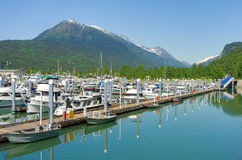 Vessels docked at the busy port of skagway Stock Image