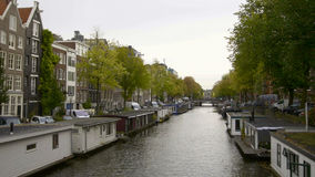 Vessels and houseboats along canals, Amsterdam, Netherlands Royalty Free Stock Photography