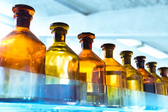 Vessels in laboratory. Blue and red tint Stock Photos