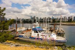 Vessels tied to wooden docks near the city of vancouver Royalty Free Stock Photos