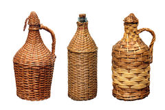 Vessels for wine in a straw braid Royalty Free Stock Images