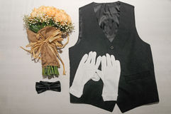 Vest bow tie and hand bouquet in one frame Royalty Free Stock Photo
