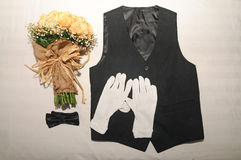 Vest bow tie and hand bouquet in one frame Stock Photo