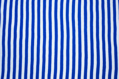 Vest. Made from knit fabric with alternating horizontal blue and white stripes Royalty Free Stock Image