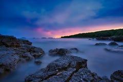 Vestar beach rocks in Croatia after sunset royalty free stock photos