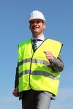 Veste e capacete de segurança amarelos Fotos de Stock