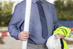 Veste e capacete de segurança levando do vis vi do topógrafo da construção olá! Fotos de Stock