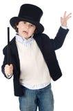 Vestido adorável da criança do illusionist com chapéu fotografia de stock royalty free