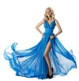 Vestido azul de la moda de la mujer, vestido que agita del vuelo elegante de la muchacha, blanco imagenes de archivo