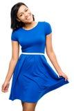 Vestido bastante azul atractivo de la mujer de la raza mixta aislado en el backgr blanco Imagen de archivo