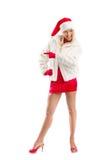 Vestido como Santa Claus Pointing Advertising Space foto de stock