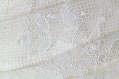 Vestido de casamento do laço fotografia de stock
