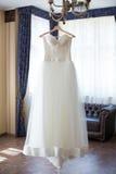 Vestido de casamento no interior Imagem de Stock Royalty Free