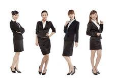 Vestido de cuatro mujeres en traje Imagenes de archivo