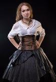 Vestido de la fantasía de la mujer que lleva foto de archivo