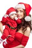 Vestido de la mamá y del bebé como santa Foto de archivo
