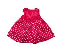 Vestido de niña pequeña rojo. fotos de archivo