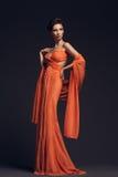 Vestido de noche de la mujer que desgasta Imagen de archivo