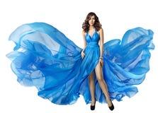 Vestido do voo da mulher, modelo de alta-costura elegante no vestido azul fotos de stock royalty free