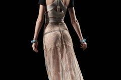 Vestido femenino transparente aislado en negro rear Imagen de archivo