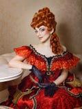 Vestido rojo de la chica joven Fotografía de archivo