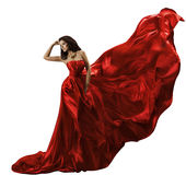 Vestido rojo de la mujer en la tela de seda que vuela blanca, que agita, modo de la belleza Imágenes de archivo libres de regalías