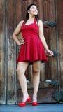 Vestido rojo lindo de la muchacha adolescente Imagen de archivo