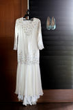 Vestido & sapatas de casamento Fotografia de Stock