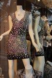 Vestido Sequined da dança na janela da loja Fotografia de Stock