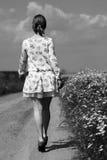 Vestido vestindo da menina Fotografia de Stock