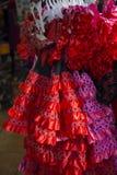 Vestidos del español para la venta en un soporte Fotografía de archivo