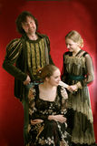 Vestidos velhos do tempo de Familyin Fotografia de Stock
