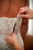 Vestindo a noiva Imagem de Stock