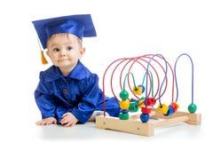 Vestiti accademici weared bambino Fotografie Stock Libere da Diritti
