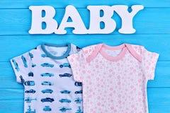 Vestiti adorabili del bambino del cotone, iscrizione Immagine Stock