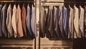 Vestiti degli uomini Immagini Stock